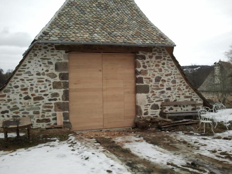 Porte de grange avec portillon en chêne